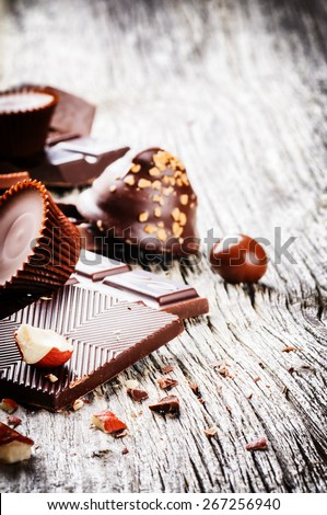 Assortment of fine chocolates and pralines on old wood background  - stock photo