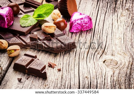 Assortment of fine chocolates and pralines with fresh mint  - stock photo