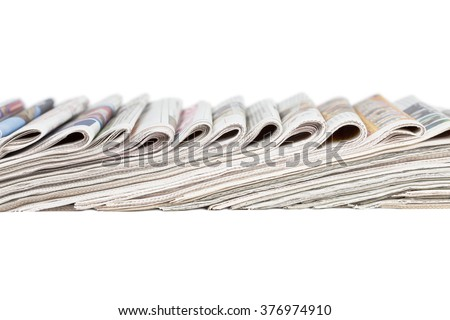 Assortment of folded newspapers isolated on white - stock photo