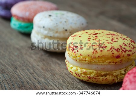 assortment of french macarons on wooden background