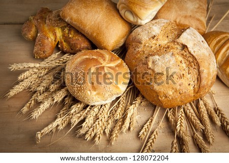 assortment of fresh baked bread on wood table