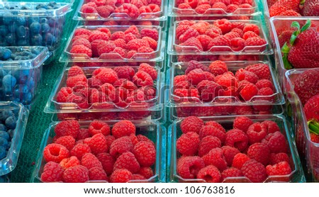 Assortment of fresh berries on display at a produce market