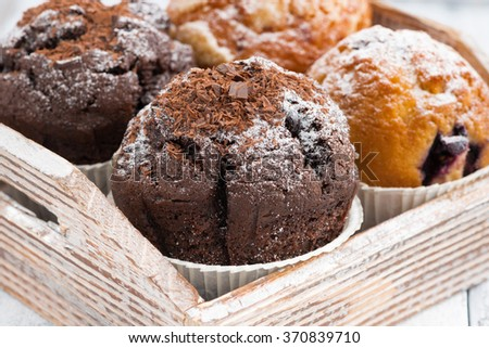 assortment of fresh delicious muffins, closeup, horizontal - stock photo