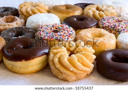 assortment of fresh donuts - focus on front donut - stock photo