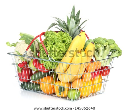 Assortment of fresh fruits and vegetables in metal basket, isolated on white - stock photo