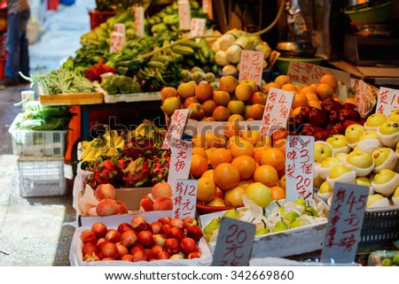Assortment of fresh fruits on outdoor market stall - stock photo
