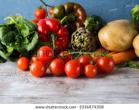 Assortment of fresh italian vegetables on wooden table