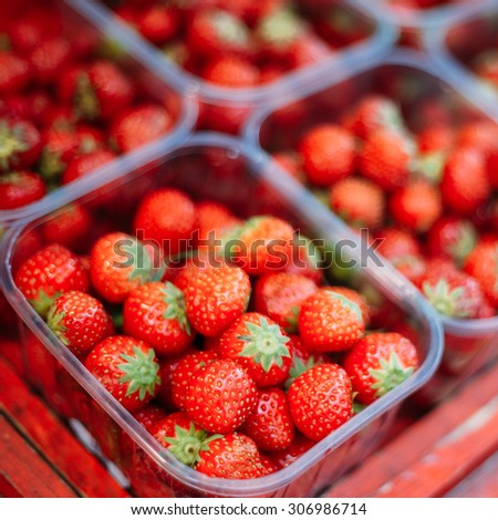 Assortment Of Fresh Organic Red Berries Strawberries At Produce Local Market In Baskets, Containers. - stock photo