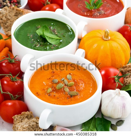 assortment of fresh vegetable cream soups and ingredients, closeup