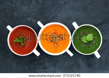 assortment of fresh vegetable soup on a dark background, top view - stock photo