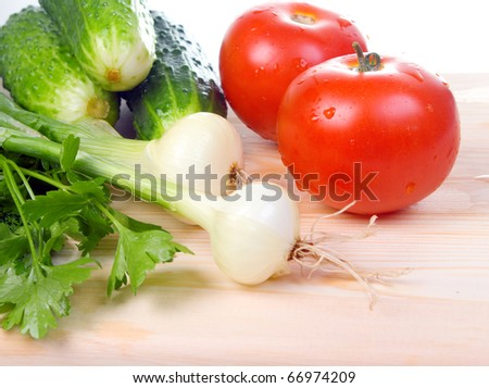 Assortment of fresh vegetables.A tomato, a cucumber - stock photo