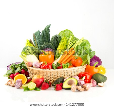 Assortment of Fresh Vegetables and Fruits in Basket on White Background - stock photo