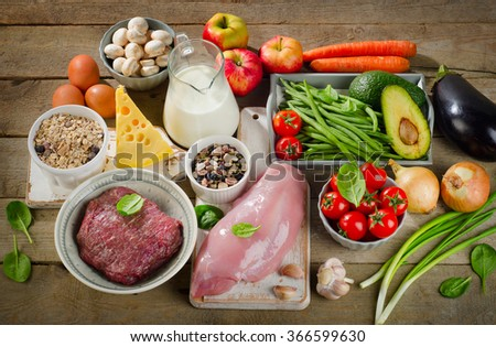 Assortment of Fresh Vegetables and Meats for Healthy Diet on rustic wooden table. Top view - stock photo