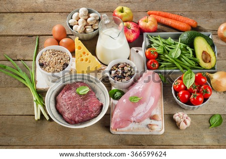 Assortment of Fresh Vegetables and Meats for Healthy Diet on  wooden background. Top view - stock photo