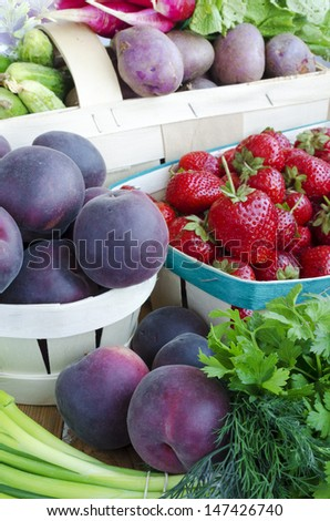 Assortment of fruits and vegetables in the baskets. Black Apricots - hybrid apricot and cherry-plum  - stock photo