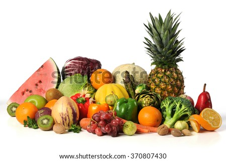 Assortment of fruits and vegetables on white background - stock photo