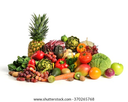 Assortment of fruits and vegetables on white table - stock photo