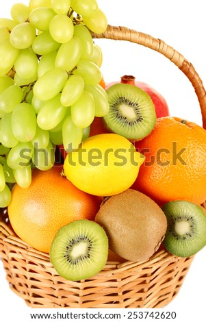 Assortment of fruits in basket close-up - stock photo