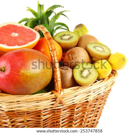Assortment of fruits in basket isolated on white - stock photo