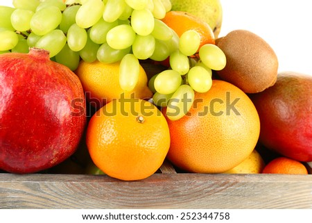 Assortment of fruits in box close-up - stock photo
