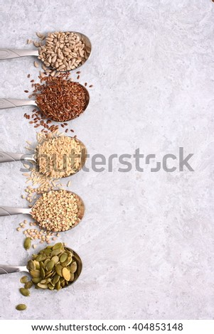 Assortment of groats and spices on table. - stock photo
