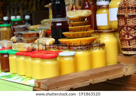 Assortment of honey on counter in market  - stock photo
