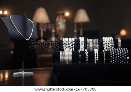 Assortment of jewelry in a jewelry shop. Close-up view - stock photo