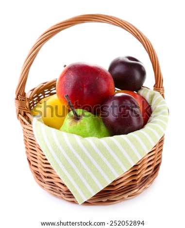 Assortment of juicy fruits in wicker basket, isolated on white - stock photo