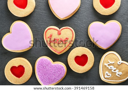 Assortment of love cookies on grey stand - stock photo
