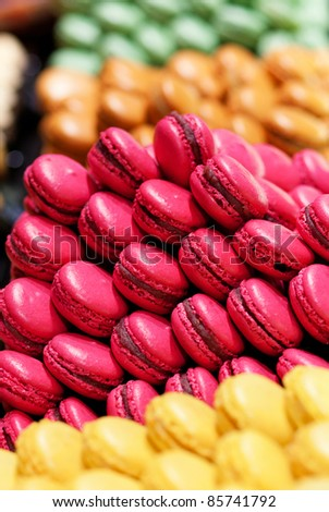 Assortment of multicolored macaroon cookies - stock photo