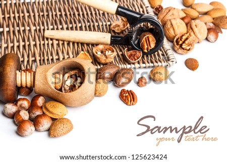 Assortment of nuts with nutcracker - stock photo