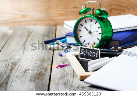 Assortment of office and school supplies on wooden table