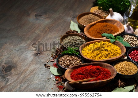 assortment of oriental spices on a wooden background, horizontal
