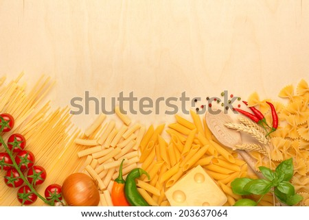 assortment of pasta, emmental and fresh vegetables - stock photo