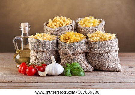 Assortment of pasta with fresh mediterranean ingredients - stock photo