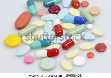 assortment of pills and capsules of colours