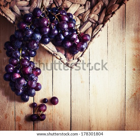 assortment of ripe sweet grapes in basket wooden background/Grapes in the basket/ Summer Wine Season - stock photo