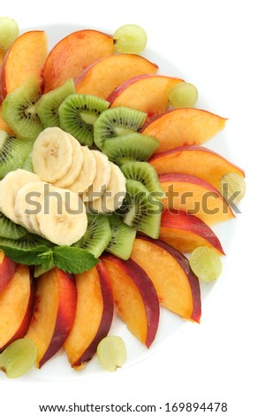 Assortment of sliced fruits on plate, isolated on white - stock photo