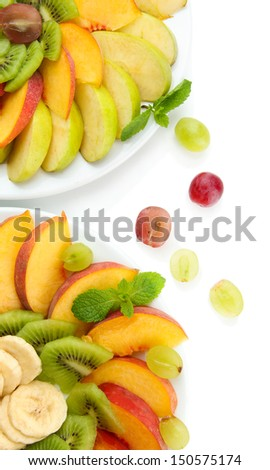 Assortment of sliced fruits on plates, isolated on white - stock photo