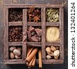 Assortment of spices and coffee beans in wooden box - stock photo