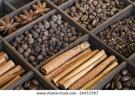 assortment of spices in a wooden box