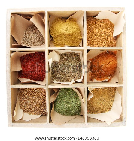Assortment of spices in wooden box,  isolated on white