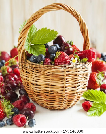 Assortment of summer fresh berries in the basket