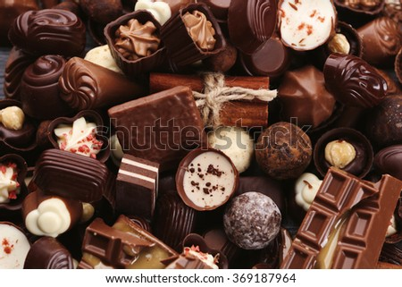 Assortment of tasty chocolate candies and cinnamon close-up - stock photo