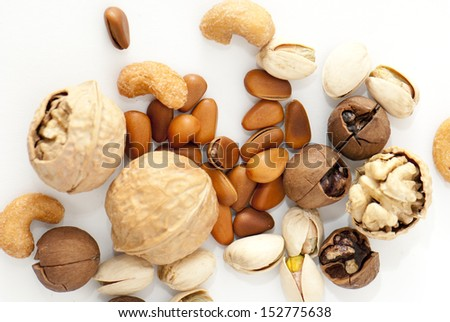 assortment of tasty nuts isolated on white
