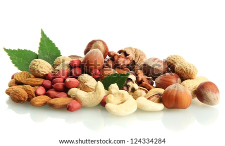 assortment of tasty nuts with leaves, isolated on white - stock photo