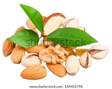 Assortment of tasty nuts with leaves isolated on white