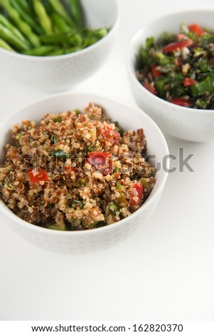 Assortment of Three Bowls with Healthy Salad Options - stock photo