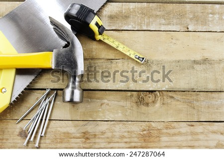 Assortment of tools on wood - stock photo