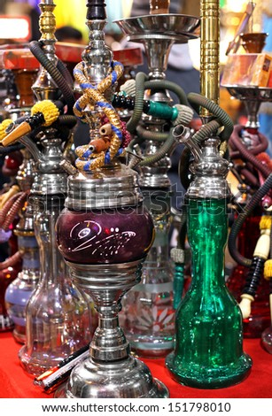 Assortment of traditional water pipes on market - stock photo